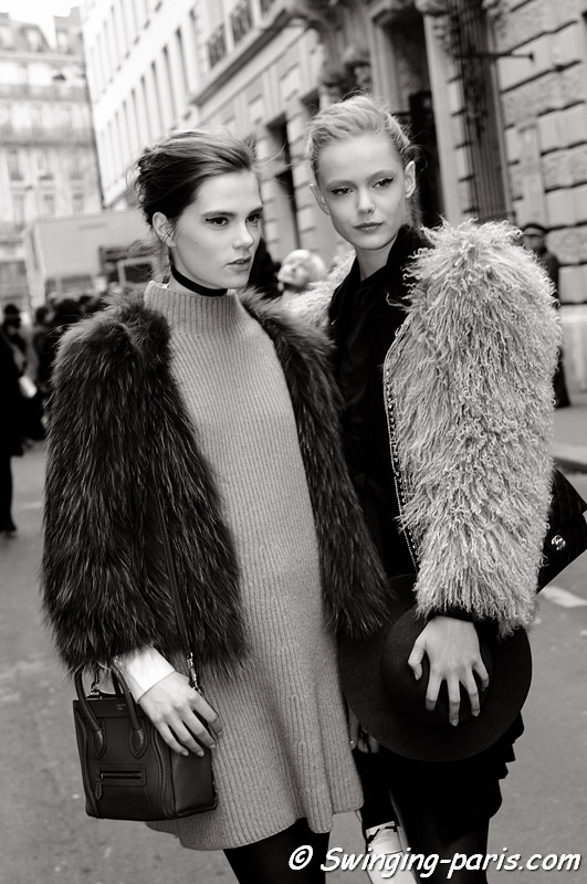 Caroline Brasch Nielsen and Frida Gustavsson exiting Chanel Spring Couture show, Paris January 2011
