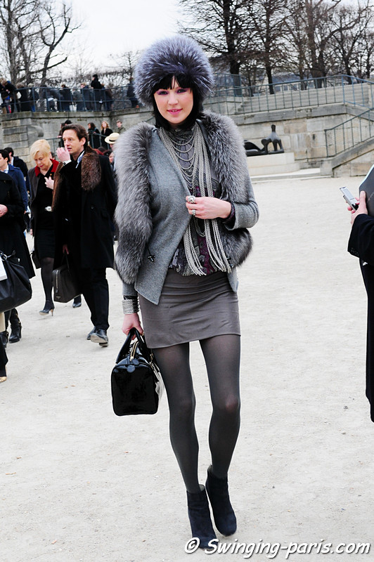 A young woman exiting Elie Saab show, Paris Fashion Week, March 2011