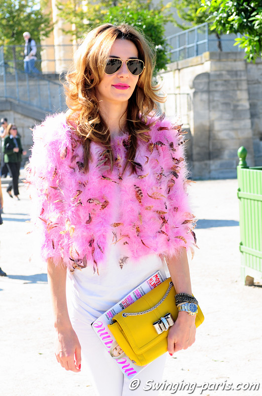 A young woman after Guy Laroche show, Paris S/S 2012 Fashion Week, September 2011