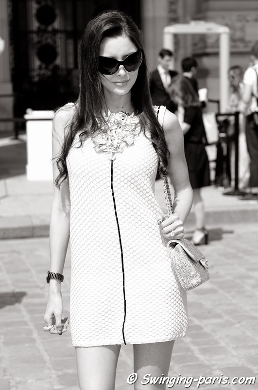 A young woman leaving Chanel show, Paris Haute Couture F/W 2013 Fashion Week, July 2013