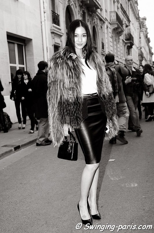 A young woman outside Christian Dior show, Paris Haute Couture F/W 2013 Fashion Week, July 2013