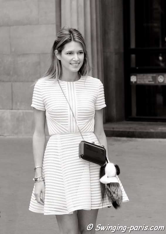 A young woman outside Elie Saab show, Paris Haute Couture F/W 2014 Fashion Week, July 2014