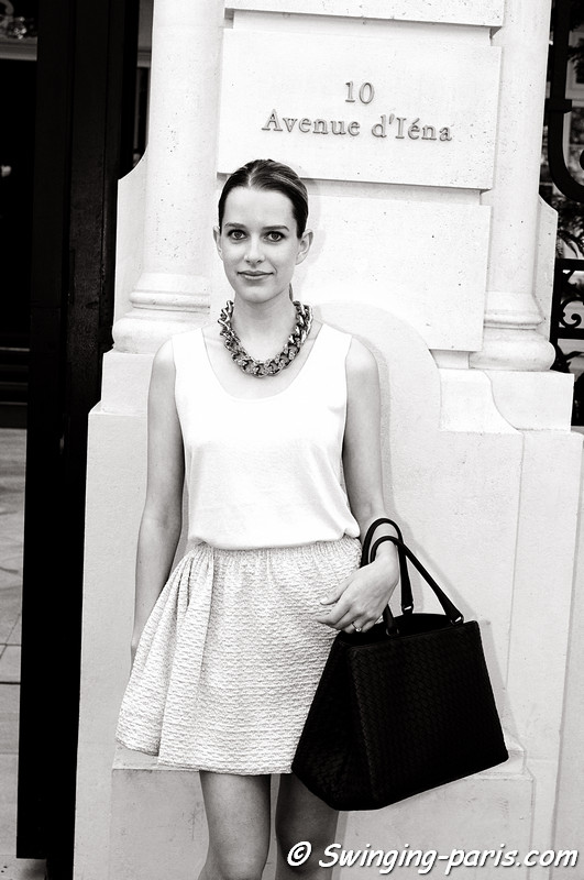 A young woman leaving Anne Valérie Hash show, Paris Haute Couture F/W Fashion Week, July 2011