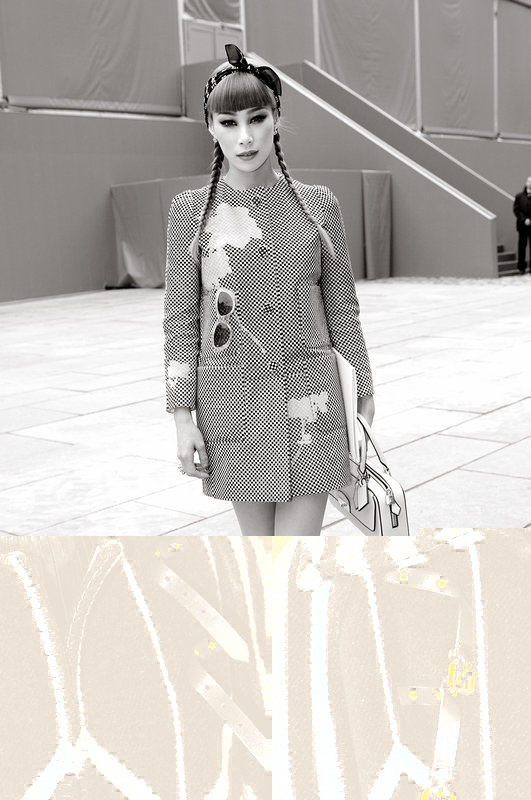 A young woman exiting Louis Vuitton show, Paris F/W 2013 RtW Fashion Week, March 2013