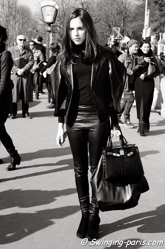 A young woman leaving Balenciaga show, Paris Fashion Week, March 2011