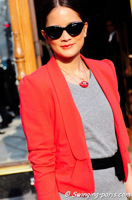 A young woman outside Balmain show, Paris Fashion Week, March 2011