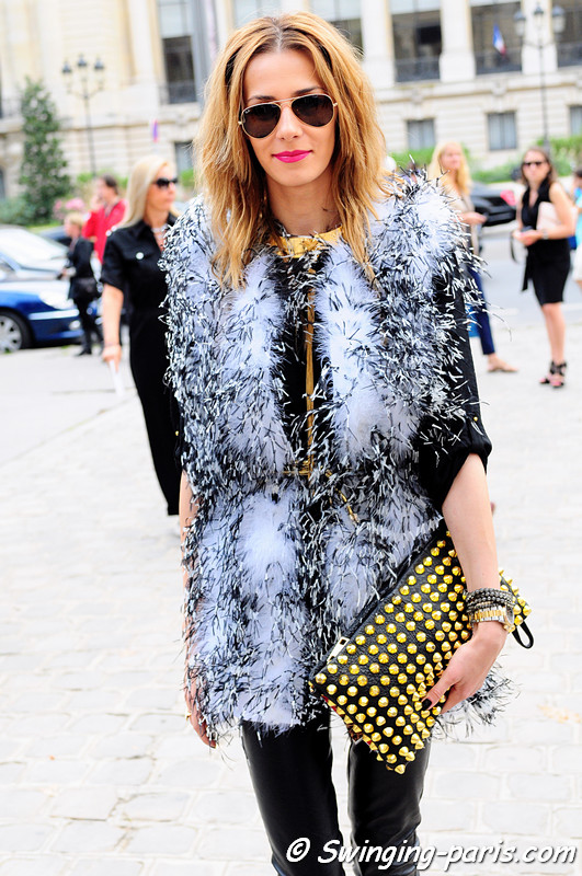 A young woman after Chanel show, Paris S/S 2012 Fashion Week, October 2011
