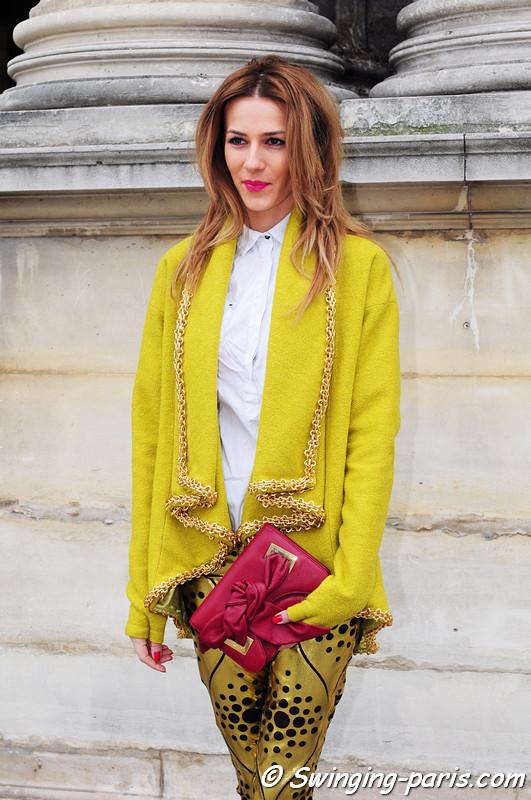 A young woman leaving Louis Vuitton show, Paris F/W RtW 2012 Fashion Week, March 2012