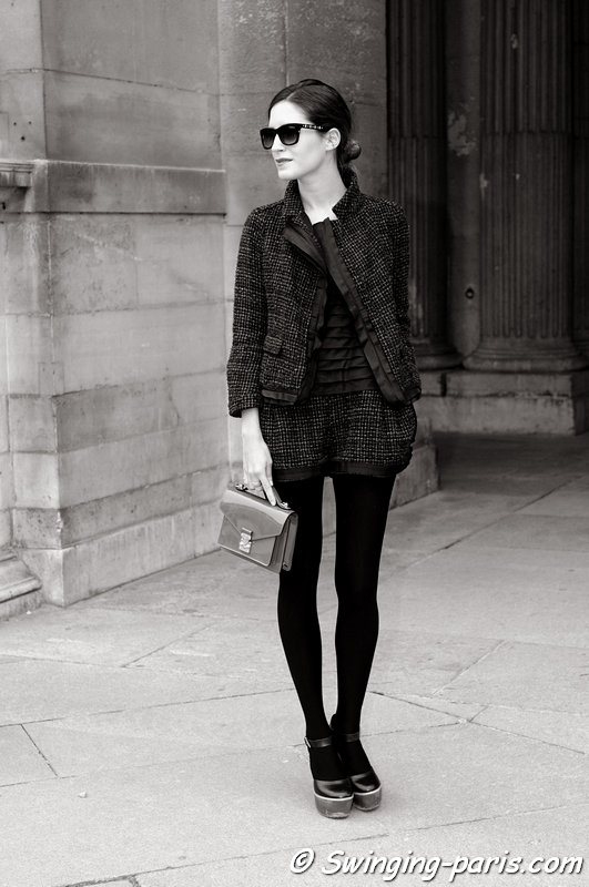 A young woman leaving Louis Vuitton show, Paris F/W RtW 2012 Fashion Week, March 2012